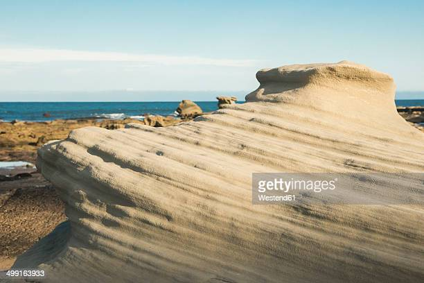 Australia, Seal Rocks, view to outwashed rocks at beach