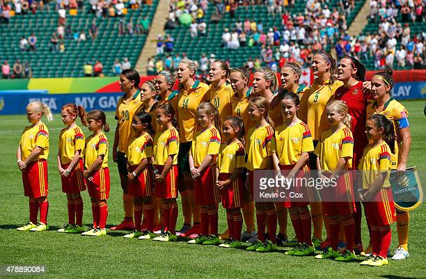 Australia stands during their National Anthem prior to the FIFA Women's World Cup Canada 2015 Quarter Final match between Australia and Japan at...