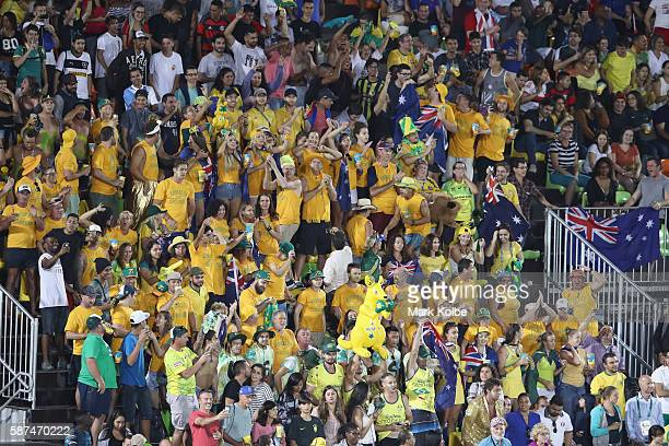 Australia supporters in the crowd cheer during the Women's Gold Medal Final Rugby Sevens match between Australia and New Zealand on August 8 2016 in...