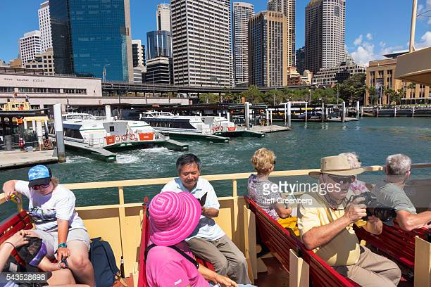 Australia Sydney CBD Central Business District Circular Quay Sydney Ferries Harbor ferry upper deck riders passengers Asian man woman city skyline...