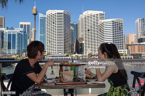 Australia Sydney Central Business District CBD Darling Harbor Cockle Bay Harbourside Shopping Center restaurant table view Asian man woman couple...
