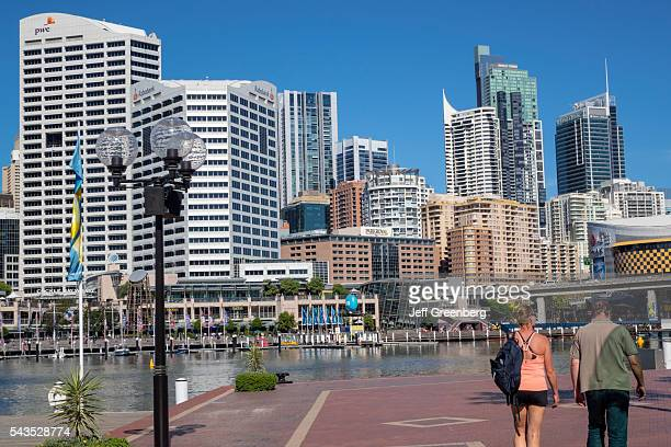 Australia Sydney Central Business District CBD Darling Harbor Cockle Bay Promenade Wharf water skyscrapers city skyline woman man couple walking