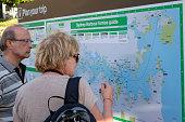 Australia Sydney Central Business District CBD Darling Harbor Passenger Terminal man woman couple Ferries route map looking