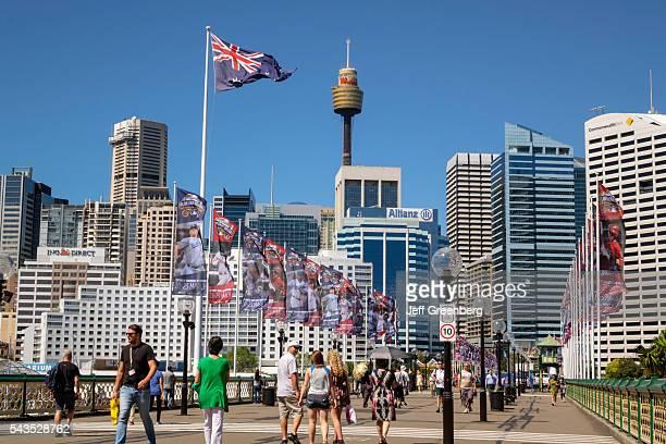 Australia Sydney Central Business District CBD Darling Harbor Pyrmont Bridge pedestrian walking Cockle Bay skyscrapers city skyline flag Sydney Tower