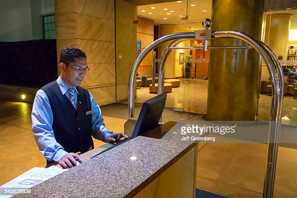 Australia Sydney Central Business District CBD Sussex Street Four Points by Sheraton Darling Harbor hotel lobby Asian man bellman bellhop service...