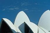 Australia, Sydney, plane flying over Sydney Opera House