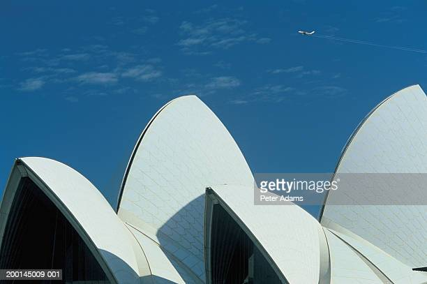 Australia, Sydney, plane flying over Sydney Opera House