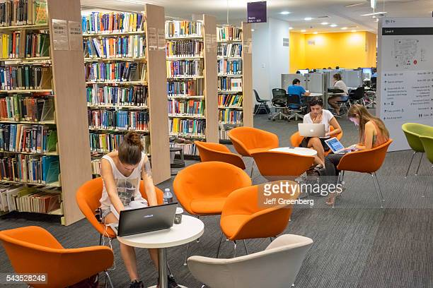 Australia Sydney UTS University of Technology Sydney campus Haymarket Library education school student studying Internet access man woman teen laptop...