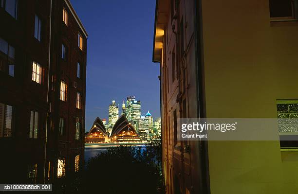 Australia, Sydney, view of opera house between apartment buildings