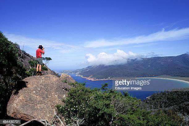 Australia Tasmania Freycinet National Park Man Looking Through Binoculars At View Over Wineglass Bay