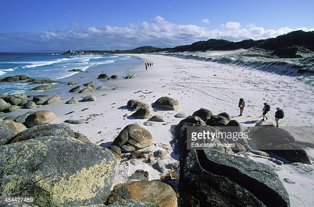 Australia Tasmania Hikers On The Beach