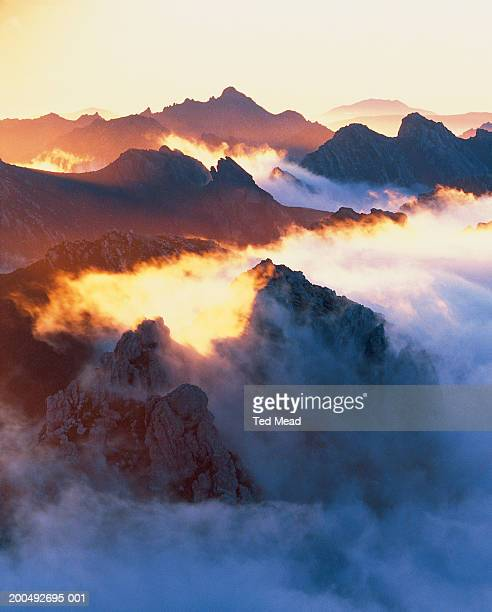 Australia, Tasmania, mountains and fog at sunrise
