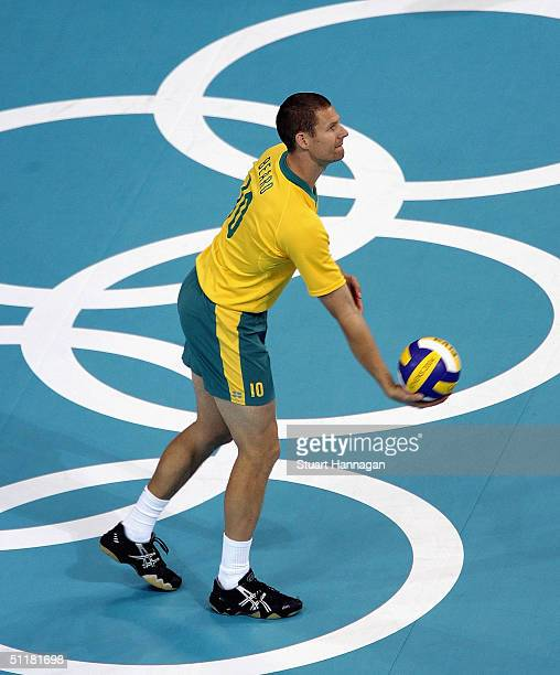 Australia team captain David Beard prepares to serve against Russia in the men's indoor Volleyball preliminary match on August 17 2004 during the...