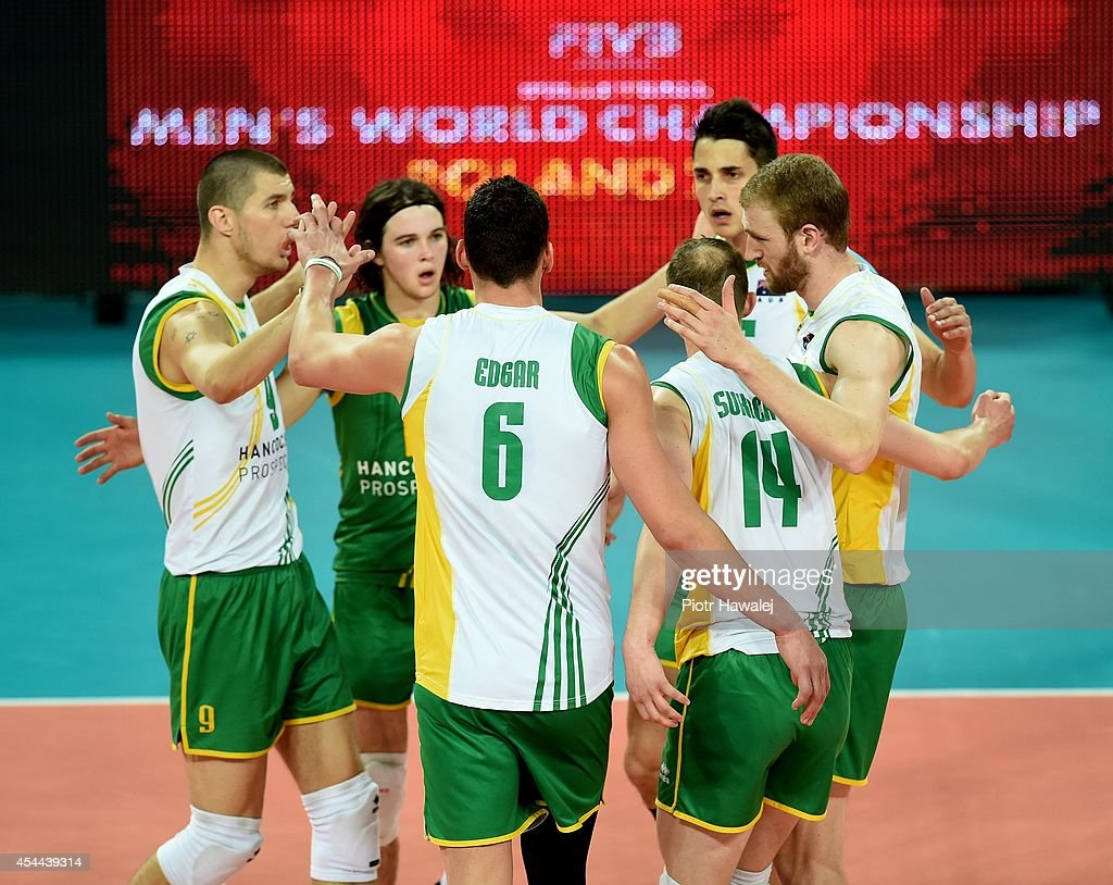 Australia team celebrate after winning a point during the FIVB World Championships match between Cameroon and Australia on August 31, 2014 in Wroclaw, Poland.