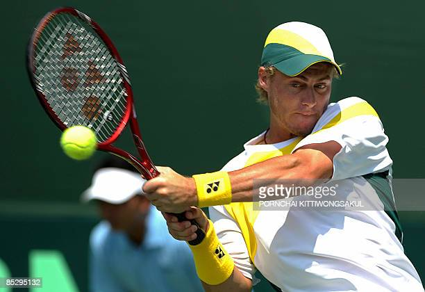 Australia tennis player Lleyton Hewitt hits a return against Danai Udomchoke of Thailand during their Davis Cup AsiaOceania Zone Group One Second...