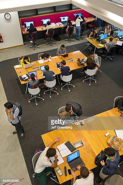 Australia Victoria Melbourne Carlton Parkville University of Melbourne campus school Baillieu Library student man woman boy girl teen studying laptop...