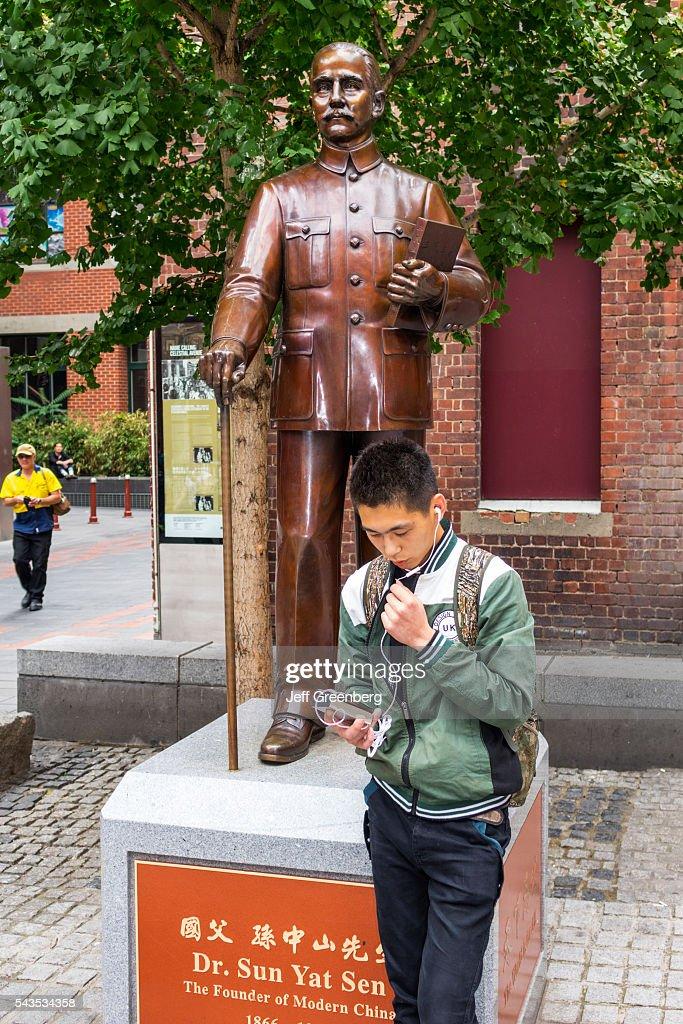 Australia Victoria Melbourne Central Business District CBD Chinatown Little Bourke Street Asian boy teen ear bud smartphone Dr Sun Yat Sen statue