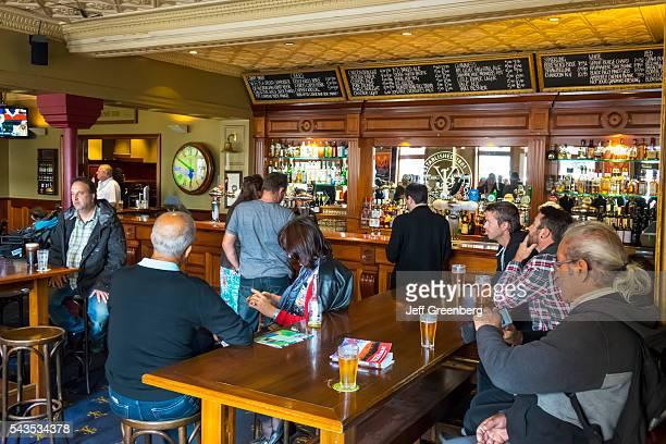 Australia Victoria Melbourne Central Business District CBD Flinders Street Young and Jackson Bar Brasserie Chloe's Rooms pub inside man woman...