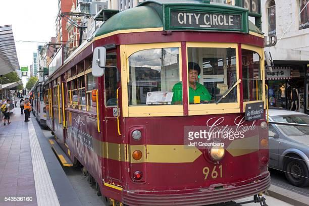 Australia Victoria Melbourne Central Business District CBD Yarra Trams tram trolley tramway public transportation City Circle Route Black woman...