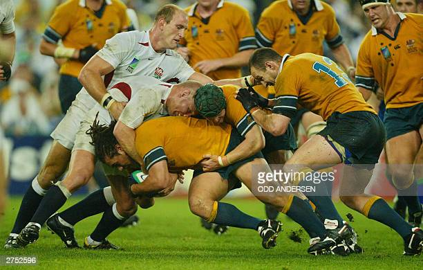Wallaby players flanker George Smith centre Elton Flatley and centre Stirling Mortlock push in the scrum with English players flanker Neil Back and...