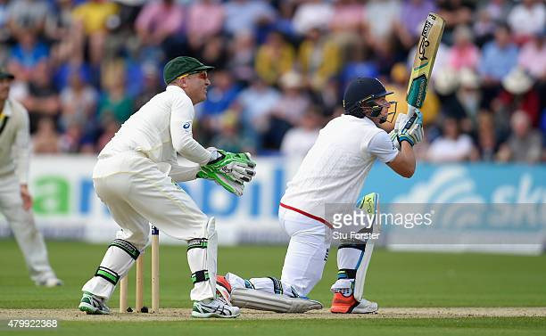 Australia wicketkeeper Brad Haddin looks on as England batsman Jos Buttler hits out during day one of the 1st Investec Ashes Test match between...