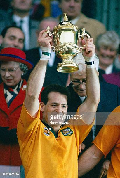 Australia winger David Campese lifts the World Cup after the 1991 Rugby Union World Cup Final between England and Australia at Twickenham on November...