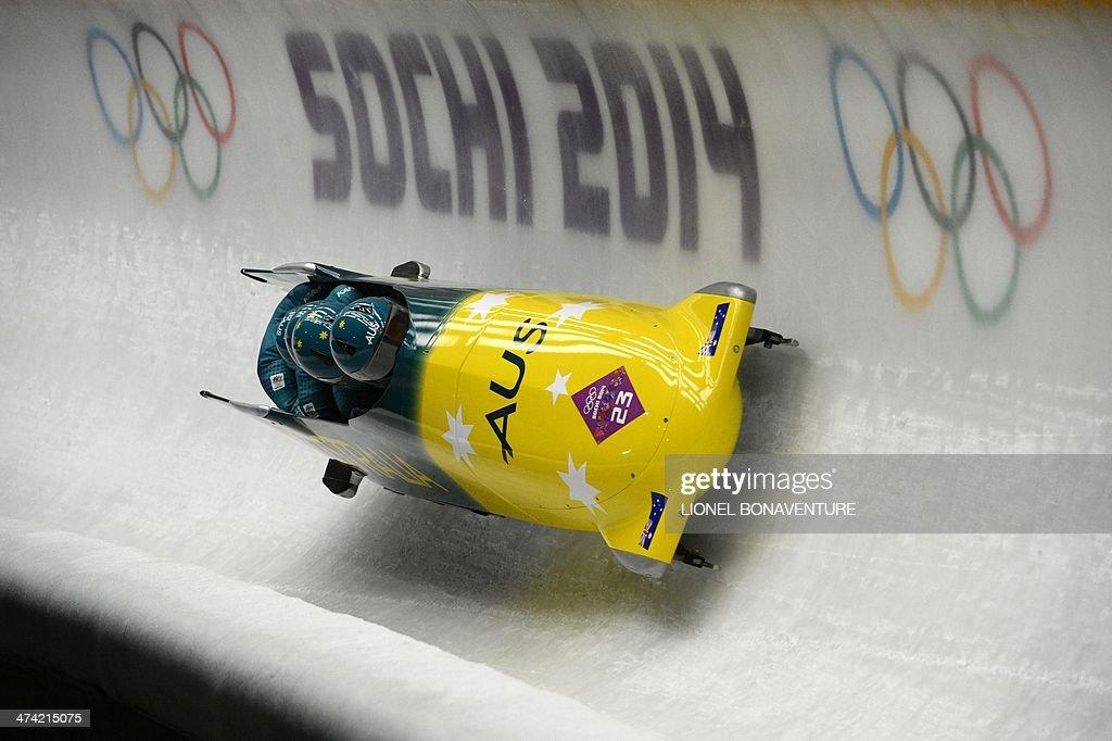 Australia-1 four-man bobsleigh pilot Heath Spence, pushman Gareth Nichols, pushman Duncan Harvey and brakeman Lucas Mata compete in the Bobsleigh Four-man Heat 2 at the Sanki Sliding Center during the Sochi Winter Olympics on February 22, 2014.