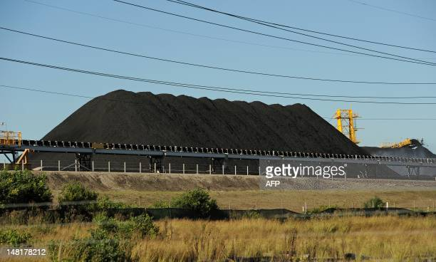 STORY 'AustraliaclimatewarmingminingAsiaUNFEATURE' by BY This photo taken on April 25 2012 shows coal stockpiled at the coal port of Newcastle in...