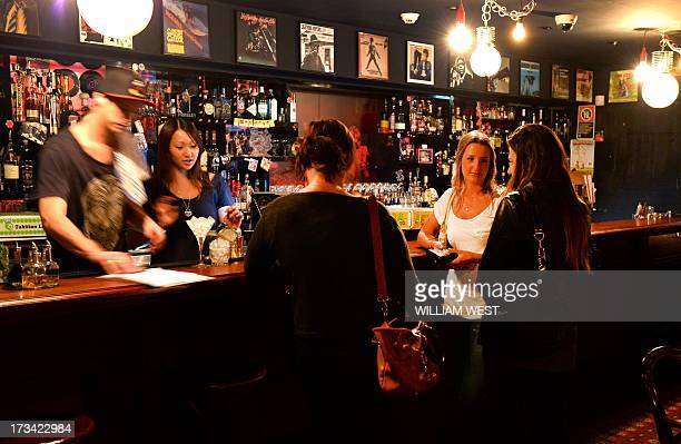 AustraliaLifestyledrinkingbarsfooddrink by Madeleine Coorey Manager Natalie Ng serves customers at the Mojo Record Bar a warm bar which hides behind...