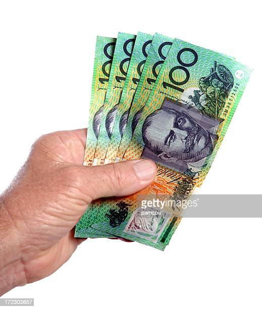 Australian 100 dollar notes cash in the hand white background