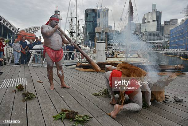 Australian aboriginal elders perform a smoking ceremony to welcome members of the Polynesian Voyaging Society on the voyaging canoe Ho¯ku¯lea on its...