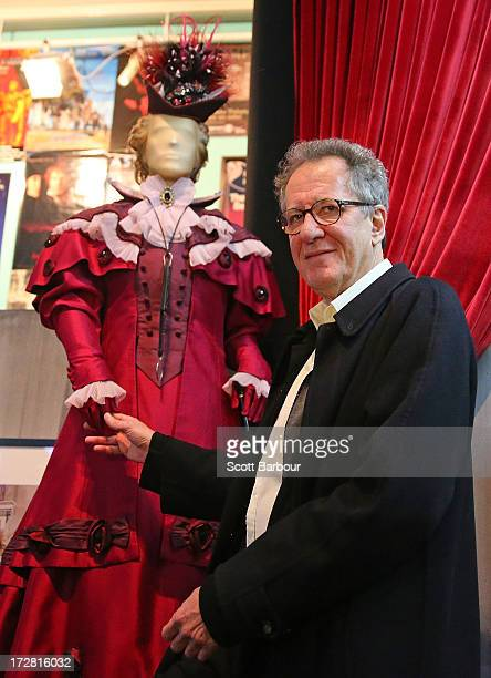 Australian actor Geoffrey Rush poses next to the costume we wore when he played Lady Bracknell in 'The Importance of Being Earnest'as he attends the...