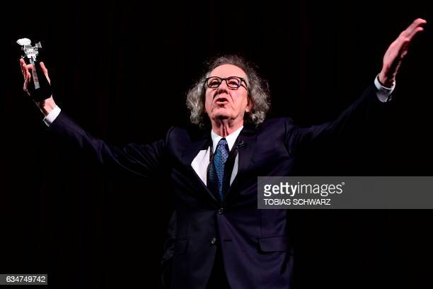 TOPSHOT Australian actor Geoffrey Rush receives the Berlinale Camera award at the 67th Berlinale film festival in Berlin on February 11 2017 / AFP...