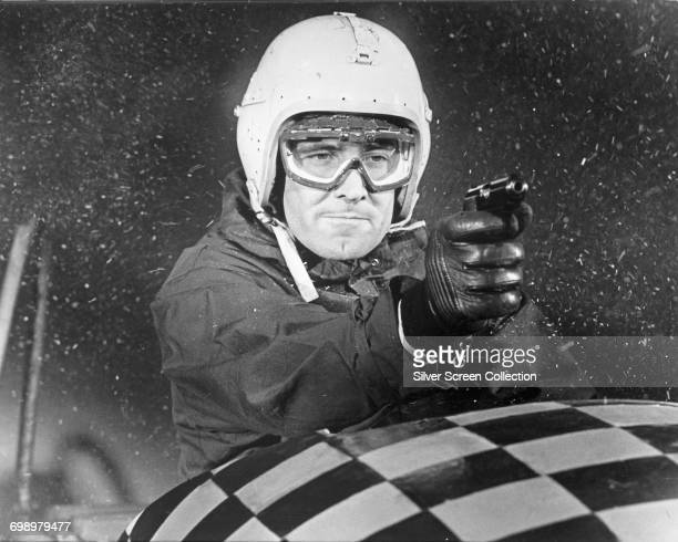 Australian actor George Lazenby as James Bond in the bobsleigh chase from the film 'On Her Majesty's Secret Service' 1969