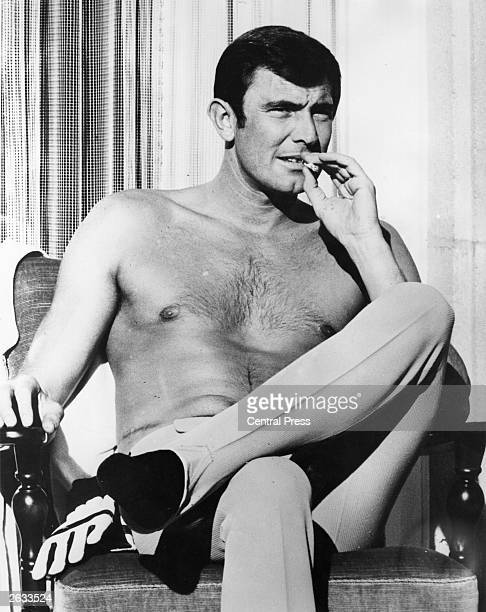 Australian actor George Lazenby relaxing during the filming of 'On Her Majesty's Secret Service' having taken over the role of Secret Agent 007 from...