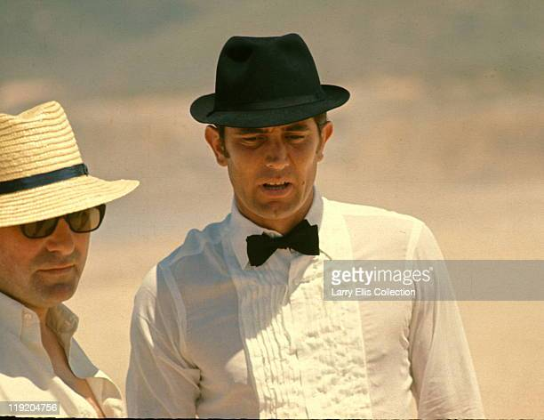 Australian actor George Lazenby with director Peter R Hunt during the filming of the James Bond film 'On Her Majesty's Secret Service' 1969