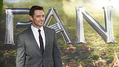 Australian actor Hugh Jackman poses for photographers as he arrives for the World Premiere of 'PAN' in London's Leicester Square on September 20 2015...