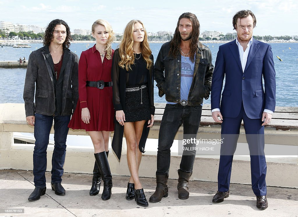 Australian actor Luke Arnold, British actresses Hannah New and Clara Paget, US actor Zach McGowan and British actor Toby Stephens pose during a photocall for the TV series 'Black Sails' as part of the Mipcom international audiovisual trade show at the Palais des Festivals, in Cannes, southeastern France, on October 7, 2013.