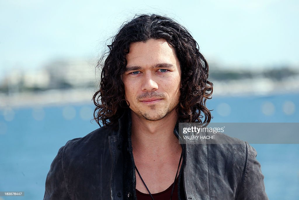Australian actor Luke Arnold poses during a photocall for the TV series 'Black Sails' as part of the Mipcom international audiovisual trade show at the Palais des Festivals, in Cannes, southeastern France, on October 7, 2013. AFP PHOTO / VALERY HACHE
