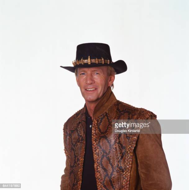 Australian actor Paul Hogan wears his Crocodile Dundee vest and hat