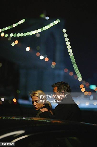 Australian actors Poppy Montgomery and Anthony LaPaglia share a tender moment as he rests his hands on her shoulders in a scene from an episode of...