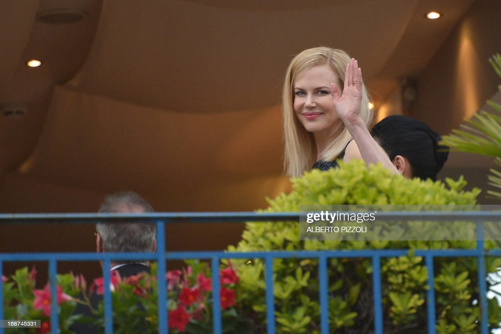 Australian actress and member of the Feature Film Jury Nicole Kidman waves on May 14, 2013 as she poses on the balcony of the Grand-Hyatt Martinez Hotel in Cannes with fellow Jury members on the eve of the 66th edition of the Cannes Film Festival. Cannes, one of the world's top film festivals, opens on May 15 and will climax on May 26 with awards selected by a jury headed this year by Hollywood legend Steven Spielberg.