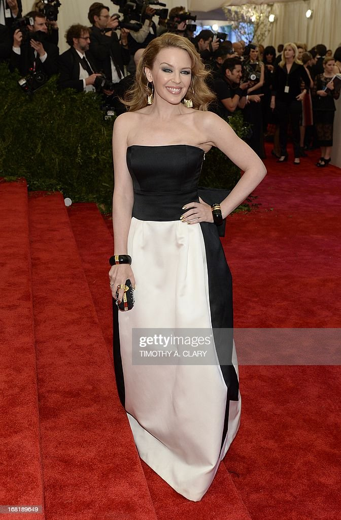 "Australian actress and singer Kylie Minogue arrives at the Metropolitan Museum of Art's Costume Institute Gala benefit in honor of the museum's latest exhibit, ""Punk: Chaos to Couture"", on May 6, 2013 in New York. AFP PHOTO/Timothy A. CLARY"