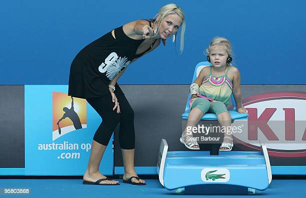Australian actress Bec Cartwright and her daughter Mia Hewitt watch Lleyton Hewitt of Australia during a practice session ahead of the 2010...
