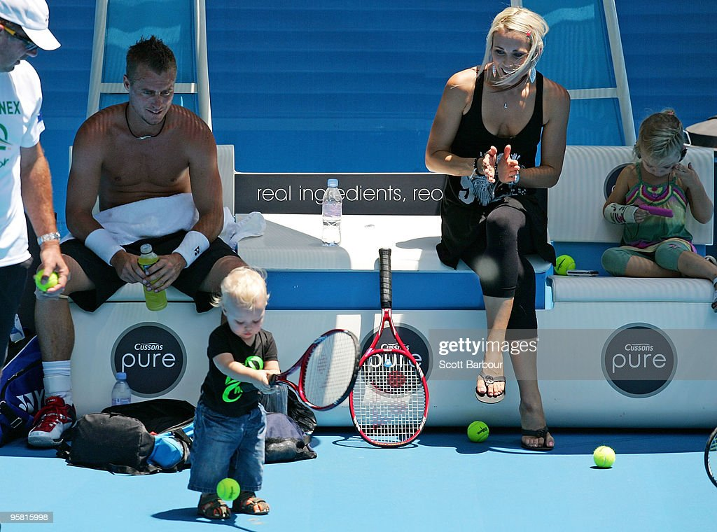 Australian actress Bec Cartwright and Lleyton Hewitt of Australia watch their son Cruz Hewitt and daughter Mia Hewitt during a practice session ahead...