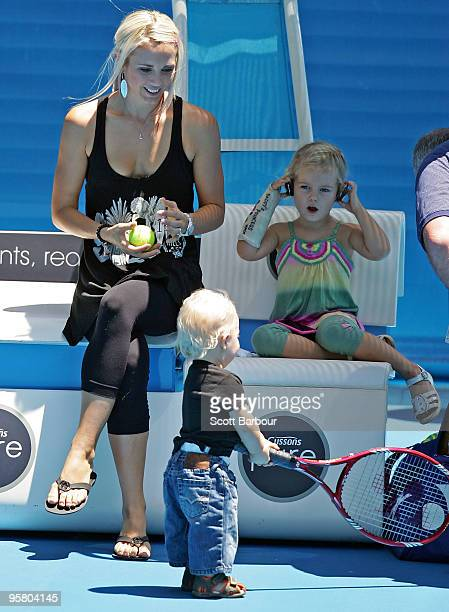 Australian actress Bec Cartwright her daughter Mia Hewitt and son Cruz Hewitt watch Lleyton Hewitt of Australia during a practice session ahead of...
