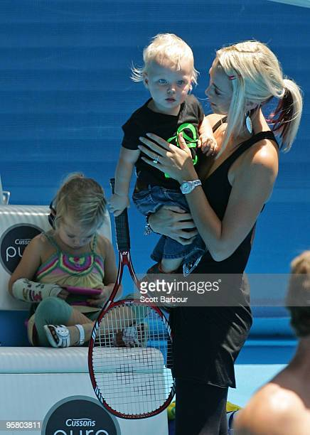 Australian actress Bec Cartwright holds her son Cruz Hewitt as daughter Mia Hewitt looks on as they watch Lleyton Hewitt of Australia during a...