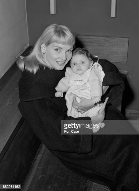 Australian actress Diane Cilento arrives at London Airport with her baby daughter Giovanna Volpe 15th February 1958