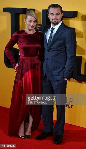 Australian actress Margot Robbie and US actor Leonardo DiCaprio pose on the red carpet together as they arrive to attend the UK premiere of film 'The...