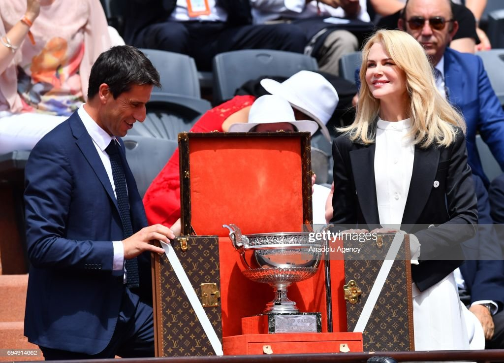 Australian actress Nicole Kidman (R) and Tony Estanguet (L), co-chairman of the Paris 2024 Organising Committee arrive with the French Open trophy for the men's final match between Stan Wawrinka of Switzerland and Rafael Nadal of Spain at the Roland Garros stadium in Paris, France on June 11, 2017.